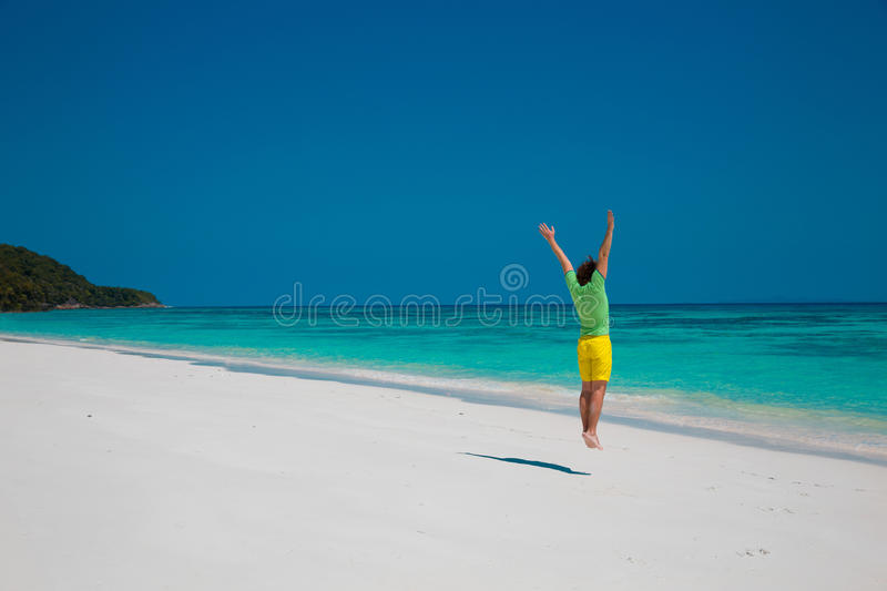 Freedom Beach Summer Holiday Concept. Handsome young man jumping stock photos