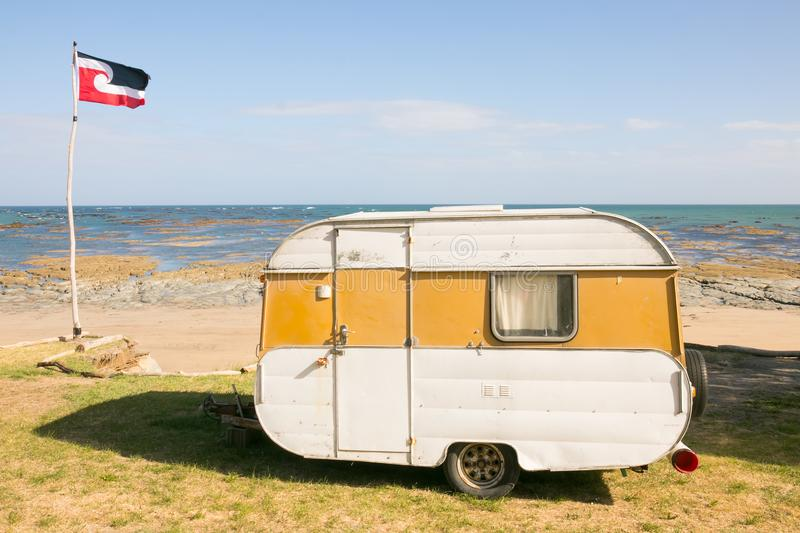 Freedom camping in caravan at an East Coast beach, Gisborne, North Island, New Zealand royalty free stock images