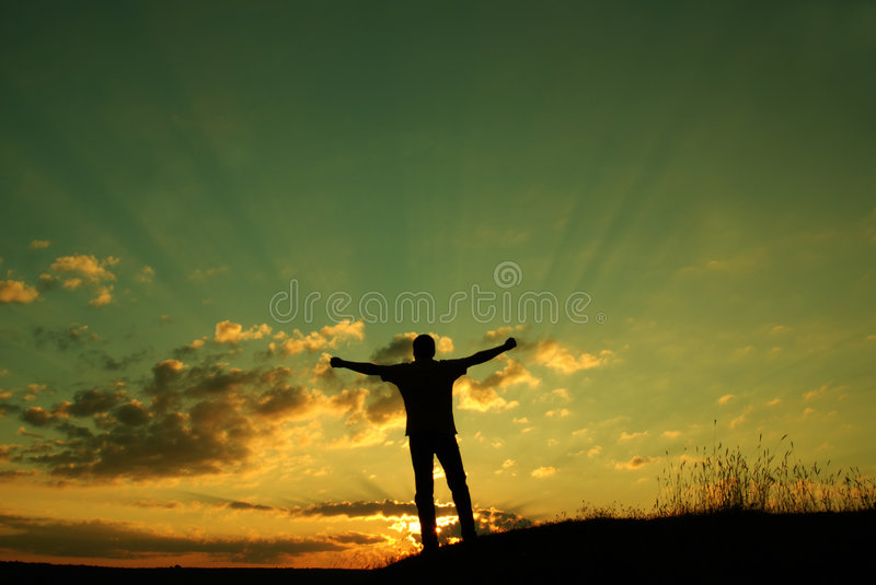 Freedom concept. The sun is rising, a man holds his arm up to the sun. New day with new opportunities. Freedom concept, religious concept royalty free stock photos