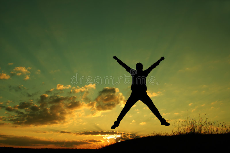 Freedom concept. The sun is rising, a man holds his arm up to the sun and jumps up. New opportunities. Freedom concept. Happiness concept royalty free stock photos