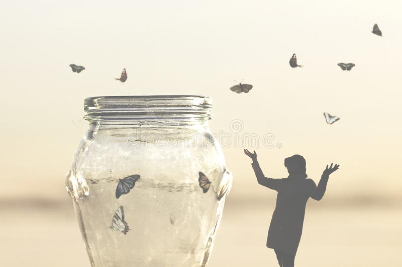 Freedom concept of a woman rescuing butterflies closed in a vase stock photos