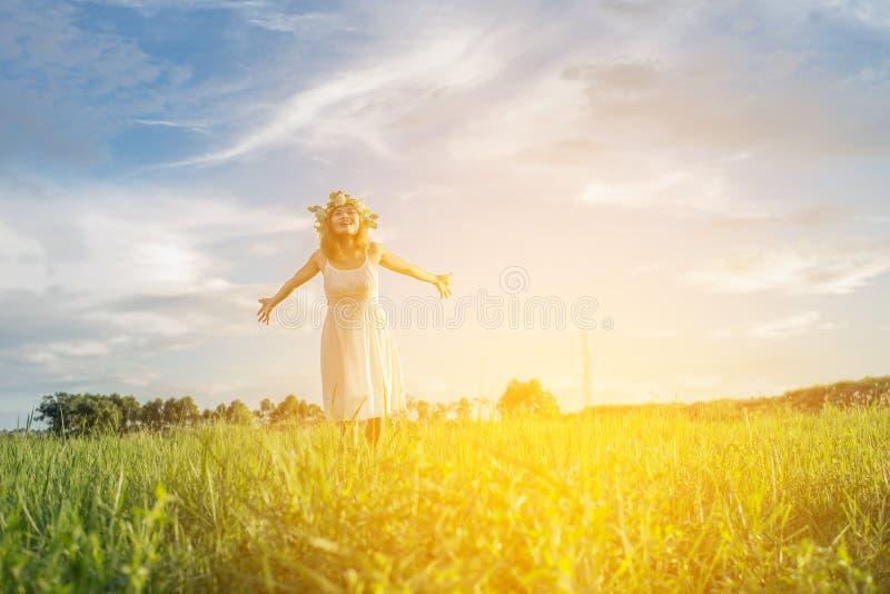 Freedom concept: Young beautiful woman enjoying with fresh air. Freedom concept Young beautiful woman enjoying with fresh air and nature at meadows stock photo