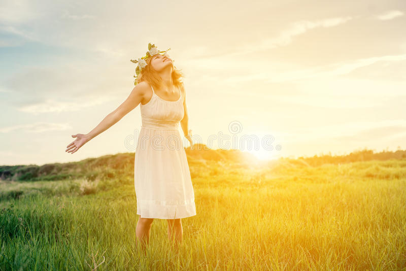 Freedom concept : Young beautiful woman enjoying with fresh air. And nature at meadows royalty free stock photos