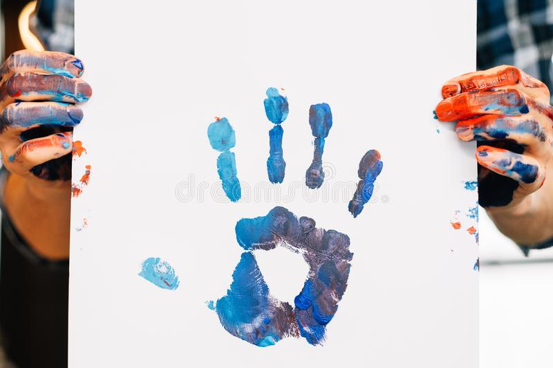 Freedom creativity paint hand print art lifestyle. Freedom creativity choice. Paint hand print on white paper. Palm raised to express individuality. Art royalty free stock photo