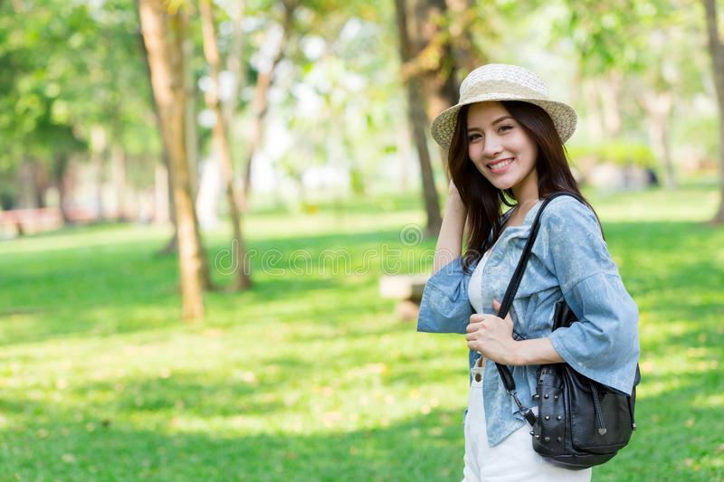 Freedom and Finding Concept: Casual cute smart Asian women walking in the park royalty free stock photo