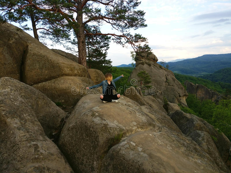 Freedom girl in mountains - Landscape Dovbush rocks stock photos