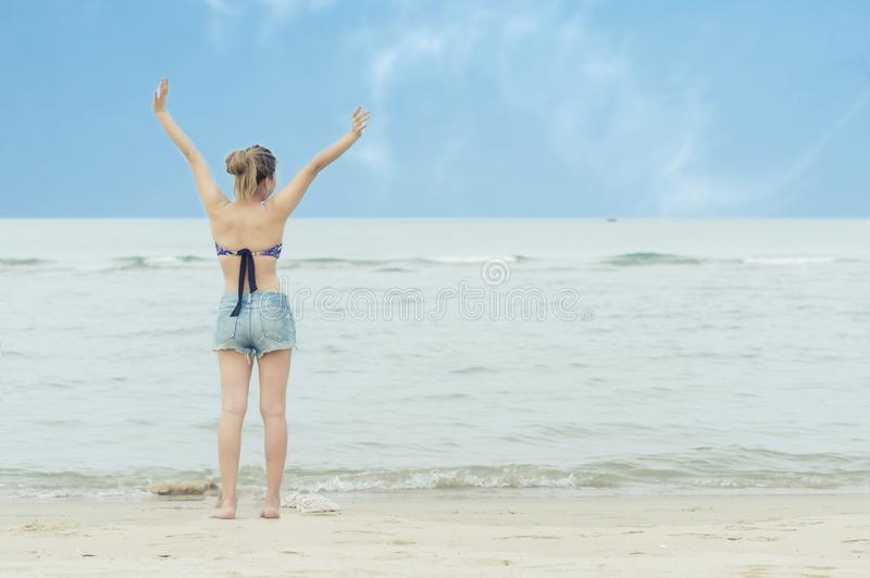 Freedom and happiness Asian young woman on the beach during travel in holiday. stock photo
