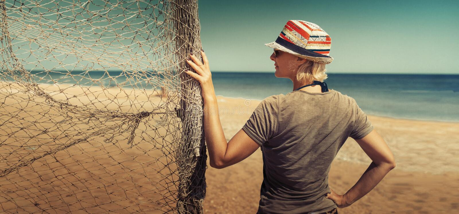 Freedom and happiness Concept. Young woman on the beach enjoy of summer sea view during travel in holiday, idea banner for text stock images