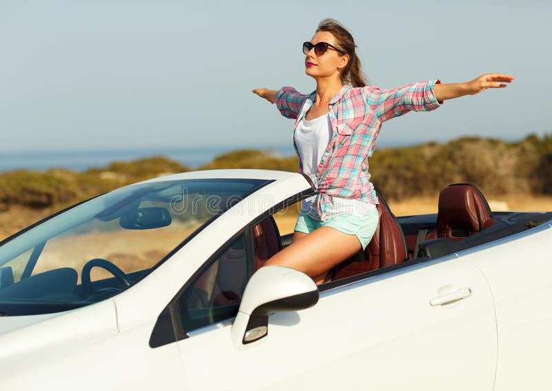 Freedom - happy free woman in cabriolet cheering joyful with arm royalty free stock photo