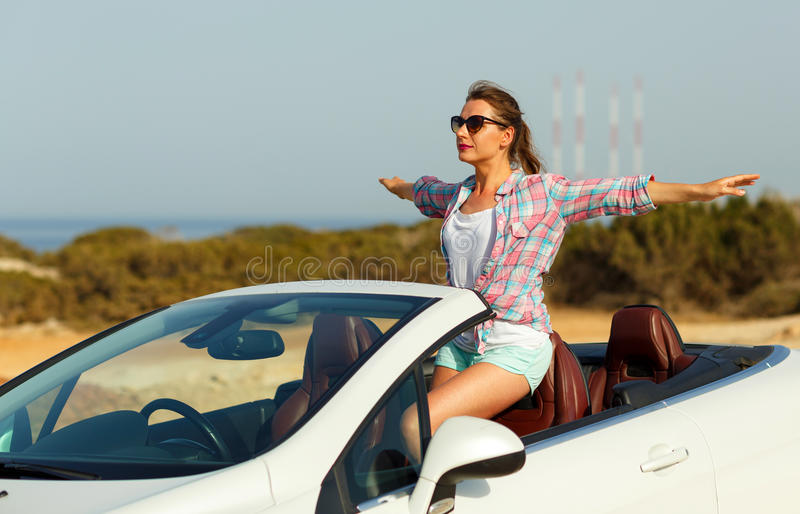 Freedom - happy free woman in cabriolet cheering joyful with arm royalty free stock images