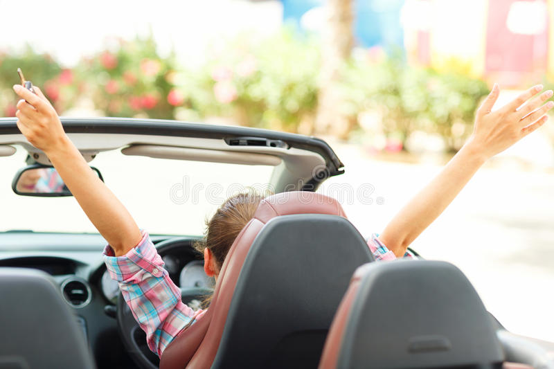 Freedom - happy free woman in cabriolet cheering joyful with arm stock photography