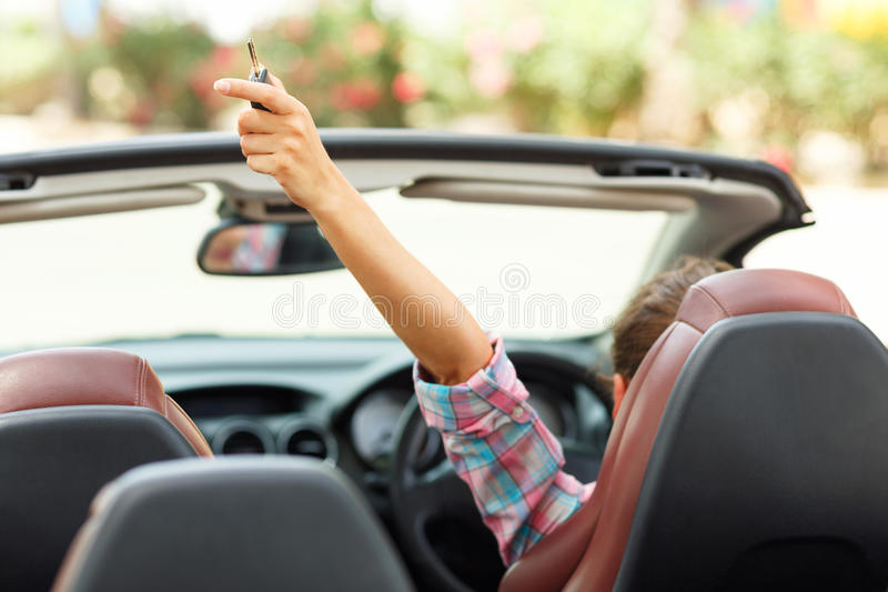 Freedom - happy free woman in cabriolet cheering joyful royalty free stock image