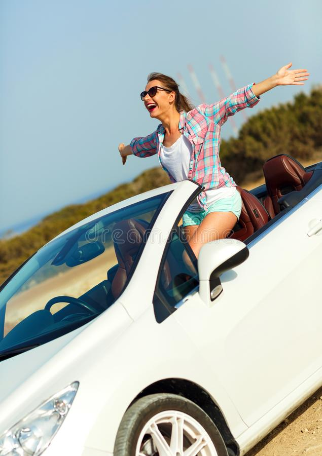 Freedom - happy free woman in cabriolet cheering joyful with arm stock images