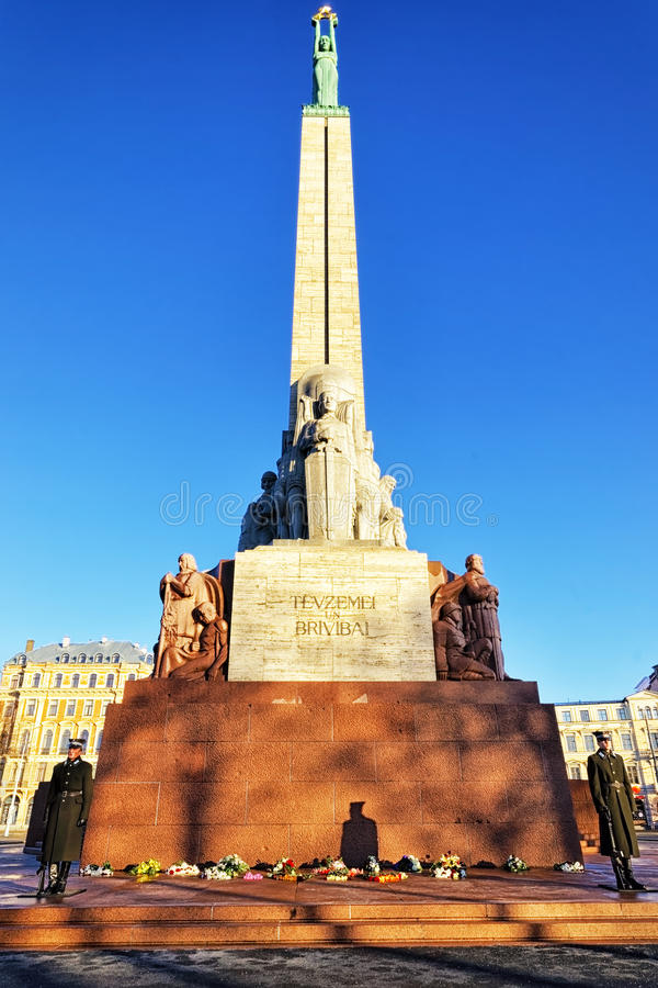 Freedom monument with honour guard in Riga, Latvia. RIGA, LATVIA - DECEMBER 25, 2011: Freedom monument with honour guard in Riga, Latvia stock photography