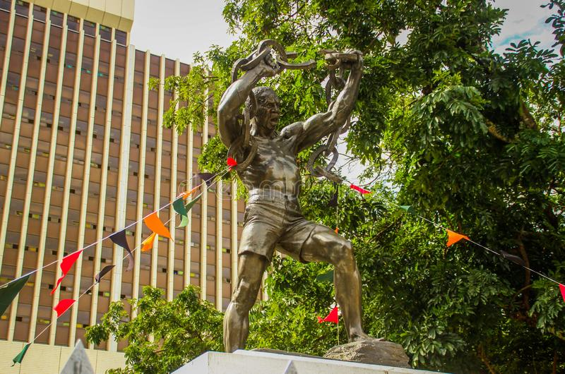 Freedom Monument - a man breaks the chains of slavery - in the center of the capital near the municipality building. Lusaka, Zambia - March 3, 2015: Freedom stock photography