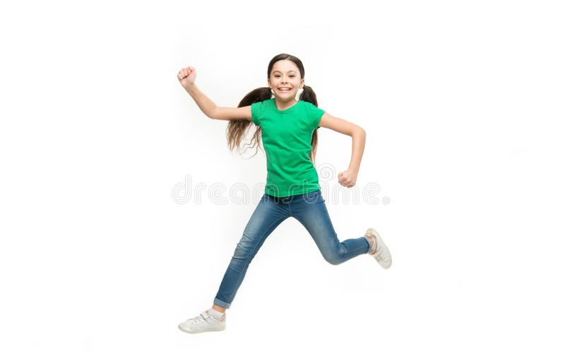 Freedom in moving. Small child wearing casual fashion style. Little fashionista. Fashionable girl child. Little girl. With long brunette hair. Small fashion stock photo