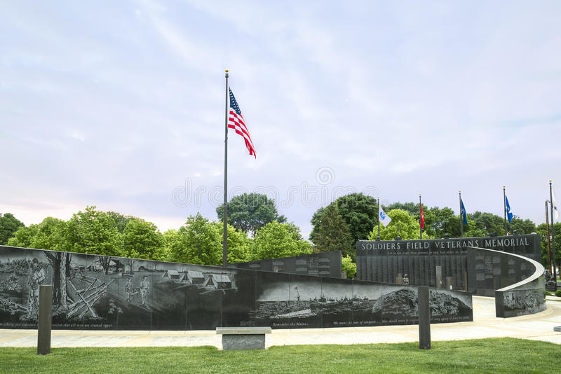 Freedom is Never Free. Soldiers field veterans memorial wall is in Rochester Minnesota with the United States of America flag waving in the breeze. Dedicated to royalty free stock image