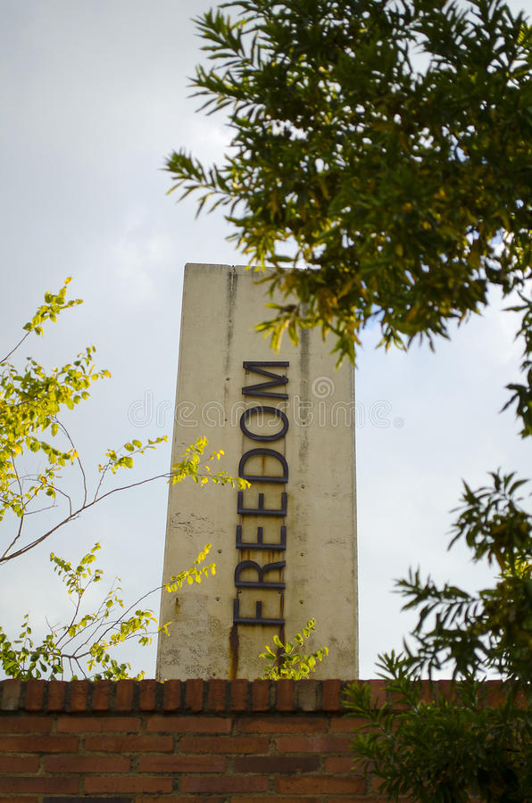 Freedom pillar at the Apartheid museum. Johannesburg, South Africa. Various, stark concrete pillars at the entrance to the Apartheid Museum, depicting the words stock images