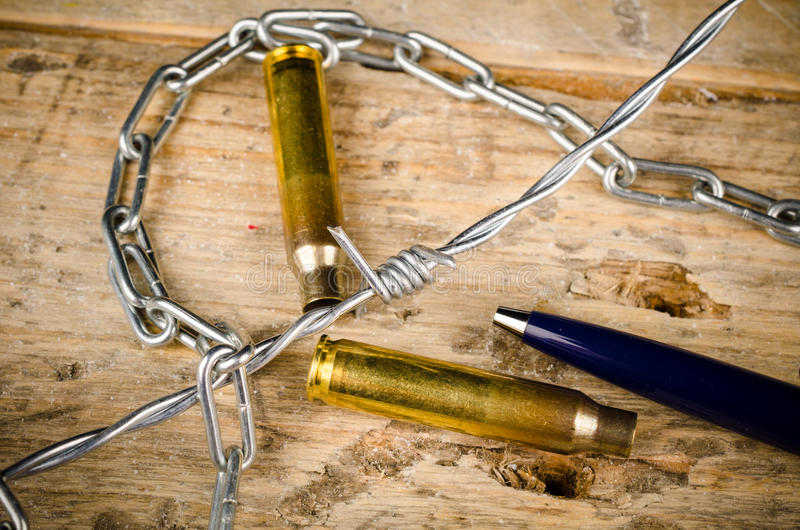 Freedom of press. Bullets and barbed wire around a pen, a press freedom concept stock images