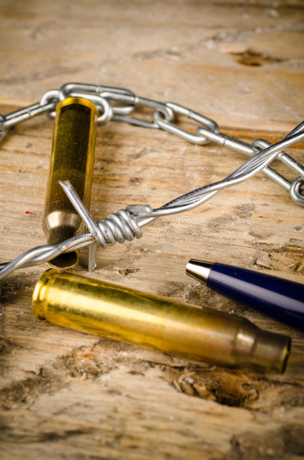 Freedom of press. Bullets and barbed wire around a pen, a press freedom concept stock photography