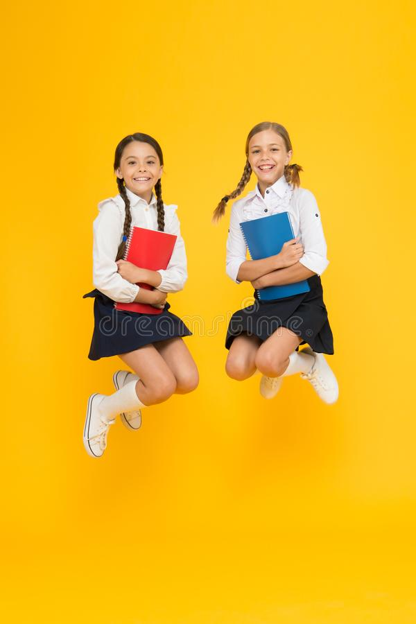 Freedom. reading story. childrens literature. cheerful classmates with workbook. dictionary notebook. Get information. Little girls in school uniform. kids stock image