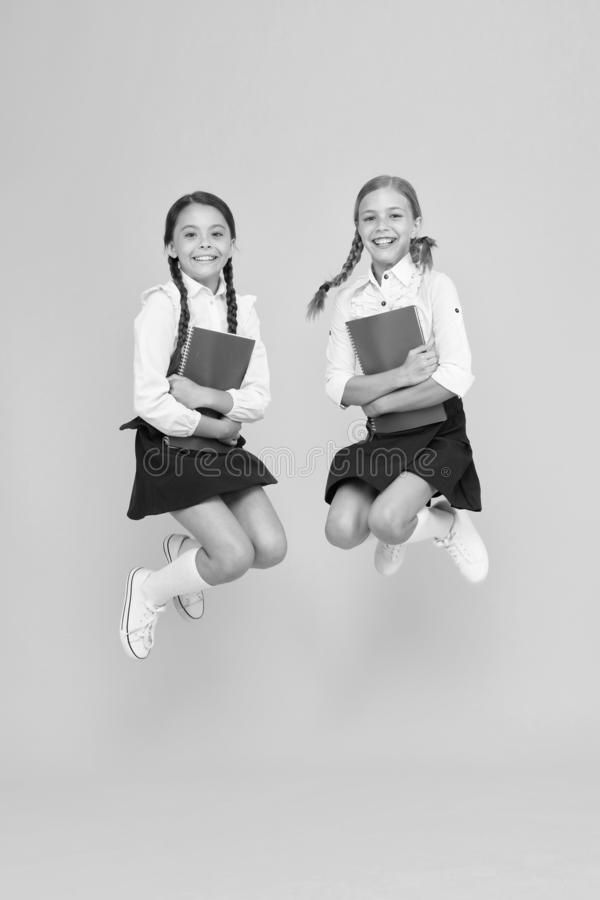 Freedom. reading story. childrens literature. cheerful classmates with workbook. dictionary notebook. Get information. Little girls in school uniform. kids stock images