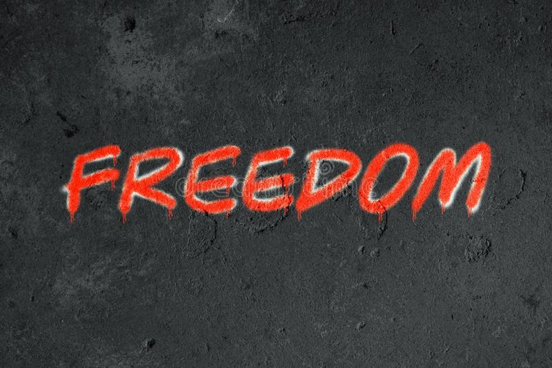 Freedom text graffiti on grunge wall. Urban, symbol, background, design, paint, street, dirty, concept, graphic, art, texture, spray, wallpaper, abstract royalty free stock image