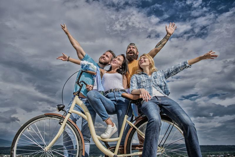 Freedom urban commuting. Bicycle as part of life. Company stylish young people spend leisure outdoors sky background. Cycling modernity and national culture stock images