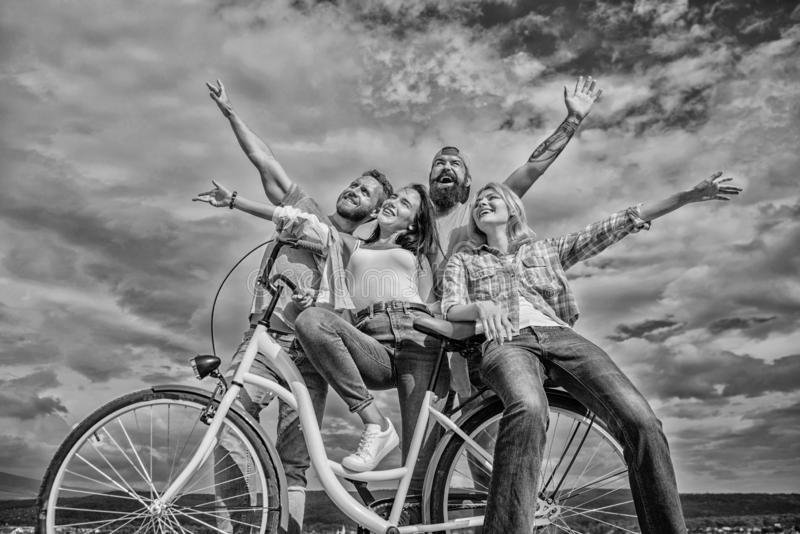 Freedom urban commuting. Bicycle as part of life. Company stylish young people spend leisure outdoors sky background stock photos