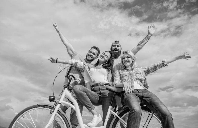 Freedom urban commuting. Bicycle as part of life. Cycling modernity and national culture. Group friends hang out with. Bicycle. Company stylish young people royalty free stock photos