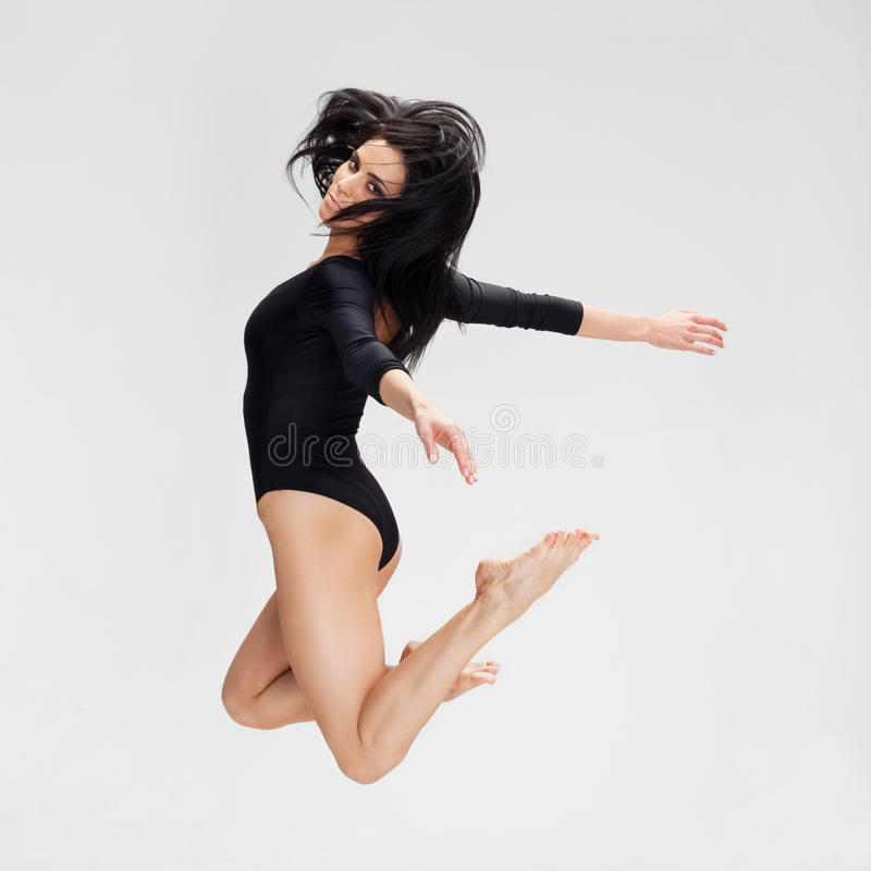 Freedom. Woman in black flying away royalty free stock images