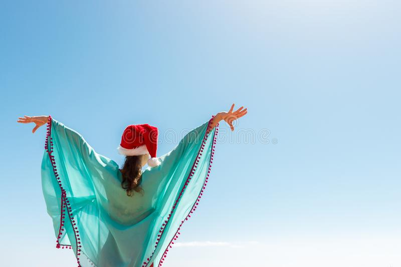 Freedom woman with christmas hat in free happiness bliss on beach. copy space stock image