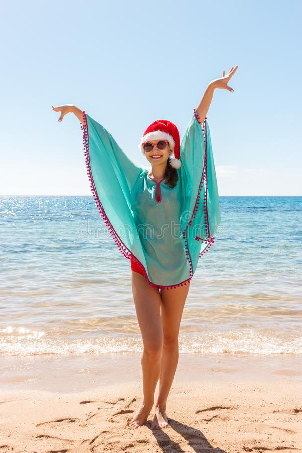 Freedom woman with christmas hat in free happiness bliss on beach stock photography