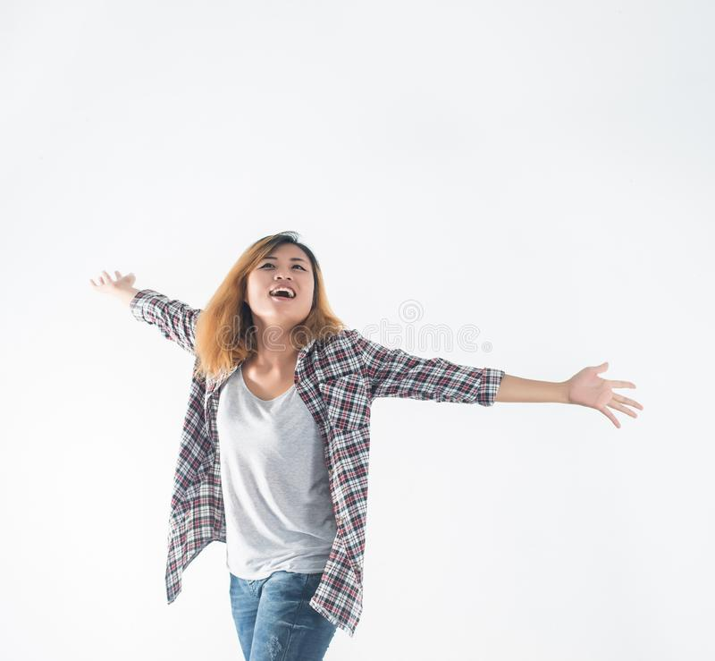 Freedom young hipster woman raising hands with isolated over a w. Hite background stock photography