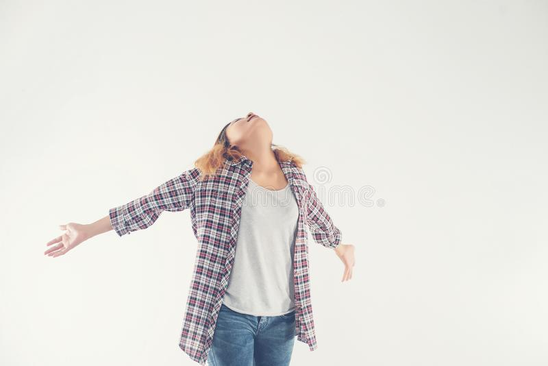 Freedom young hipster woman raising hands with isolated over a w. Hite background royalty free stock photography