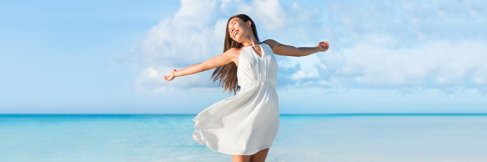 Freedom woman dancing on ocean beach background stock image