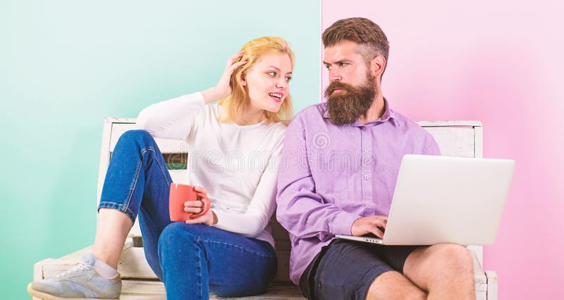 Freelance benefits. Man works as internet technologies expert on freelance. Woman smiling face drink tea or coffee near royalty free stock images