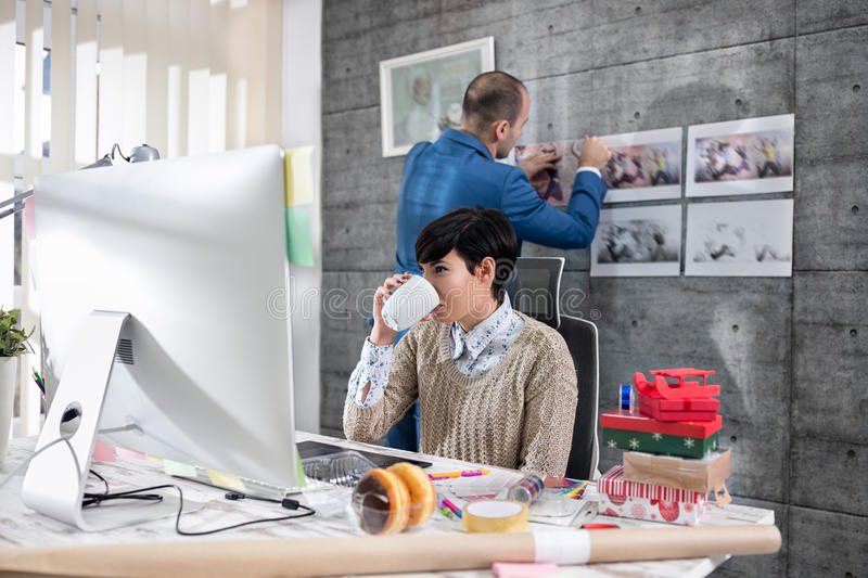 Freelance designers working. In office stock photo
