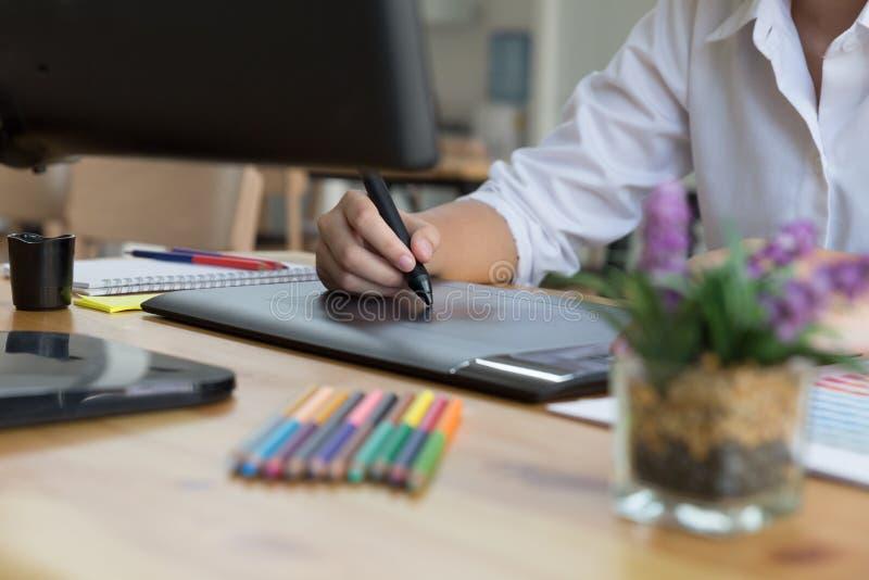 freelance graphic designer drawing on digital tablet. woman work royalty free stock photos
