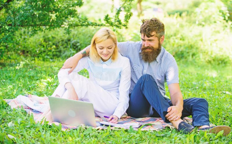 Freelance life benefit concept. How to balance freelance and family life. Couple youth spend leisure outdoors working. With laptop. Couple in love or family royalty free stock images