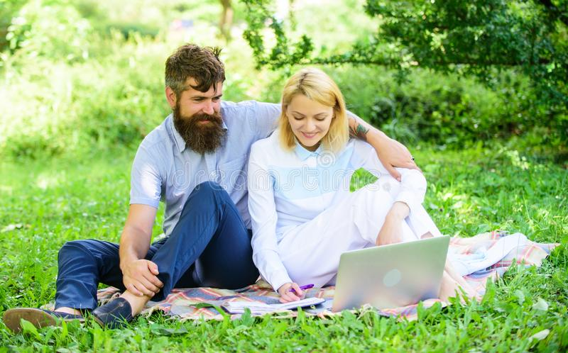 Freelance life benefit concept. How to balance freelance and family life. Couple youth spend leisure outdoors working. With laptop. Couple in love or family royalty free stock photos