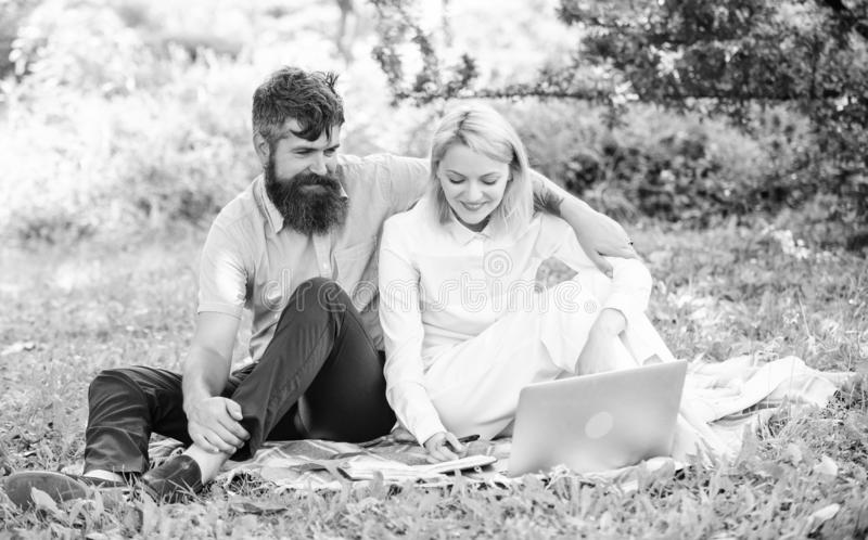 Freelance life benefit concept. How to balance freelance and family life. Couple youth spend leisure outdoors working. With laptop. Couple in love or family stock photography