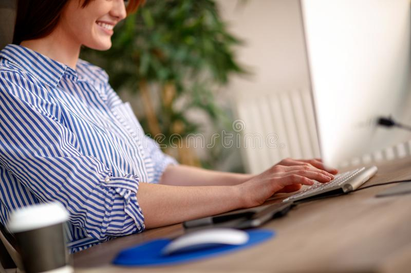 Freelance, photo editor, artist, graphic designer working on desk in creative office stock images