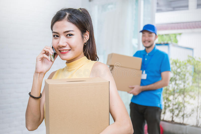 Freelance woman and man working with boxes at home concept, royalty free stock photography