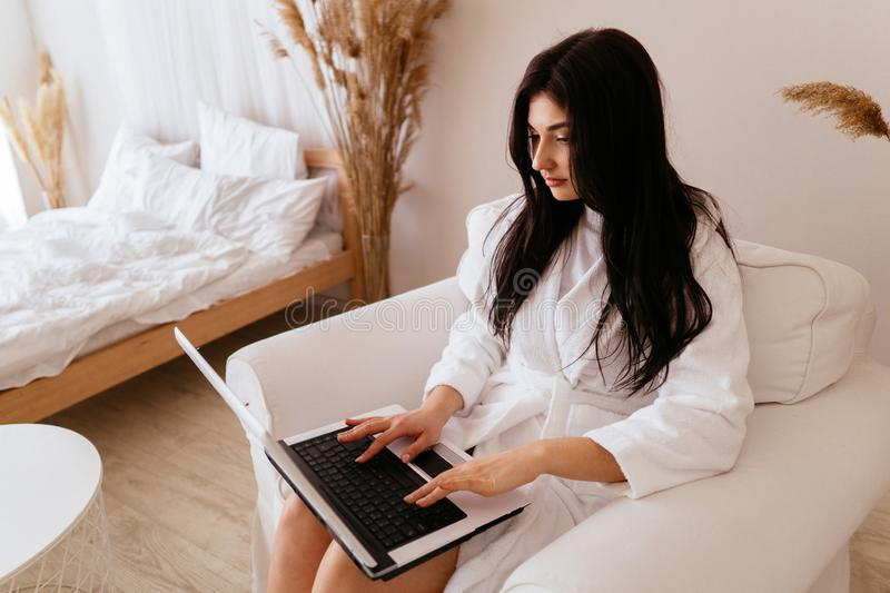 Freelance work. woman working in hotel room stock image