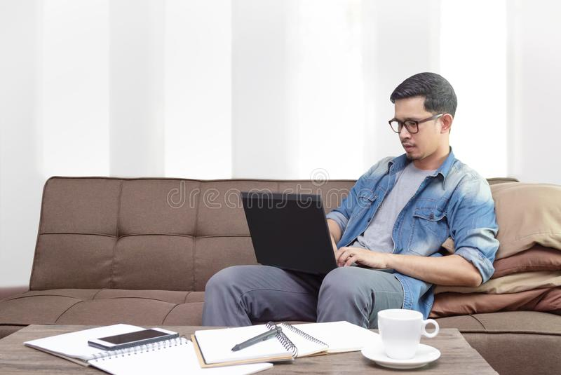 Freelance working from home using laptop royalty free stock photos