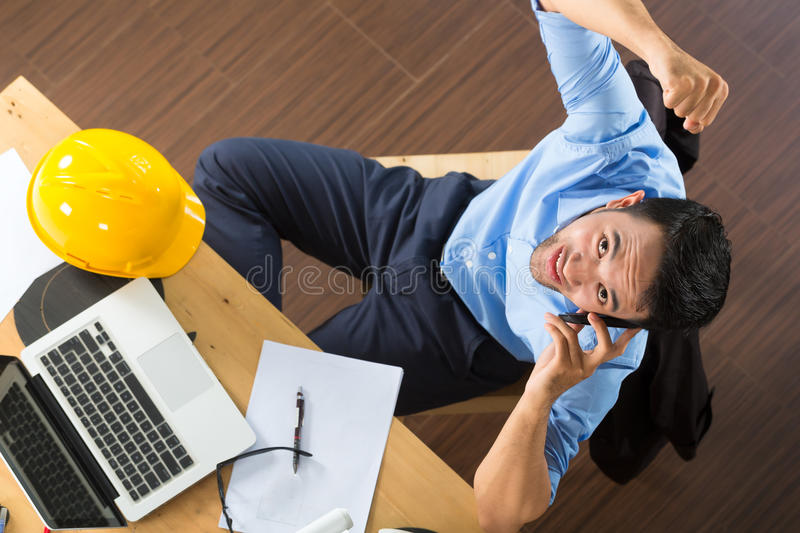 Architect working at home stock images