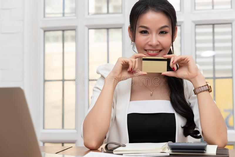 Freelancer business woman using computer laptop and credit cart to shopping online in cafe.  stock images