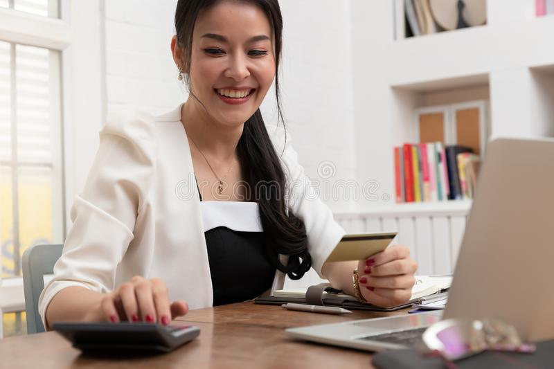 Freelancer business woman using computer laptop and credit cart to shopping online in cafe.  stock photography
