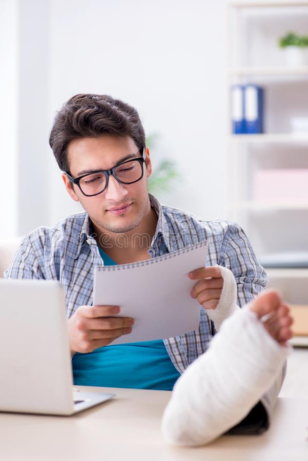 The freelancer with foot injury working from home royalty free stock photo